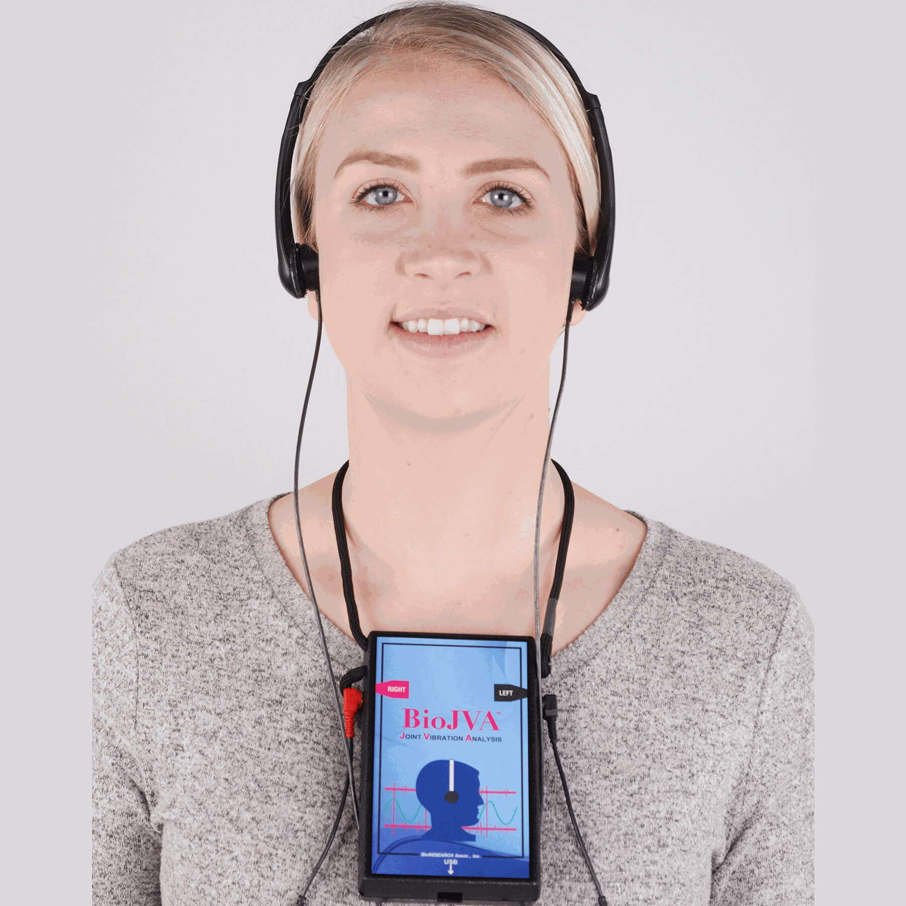 women wearing headphones with measuring device attached to chest